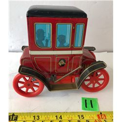 MODERN TOYS TIN CARRIAGE WITH LEVER ACTION