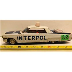 VINTAGE TIN FRICTION INTERPOL CAR WITH BATTERY OPERATED LIGHTS