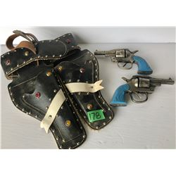 PAIR OF SIX SHOOTER CAP GUNS WITH LEATHER HOLSTER