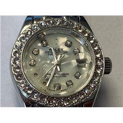 Ladies Rolex wrist watch sold without certification documents. interior jewels loose