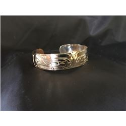 Patrick Seaweed Split Eagle Gold Bracelet , Donated by:  Friend of DEWC Appraised Value: $2000