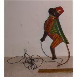 Monkey on a string old tin toy - jouet en metal singe sur corde
