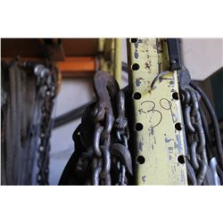 QUANTITY OF CHAINS, SHACKLES, ROPE & CORDS HANGING ON THE WALL