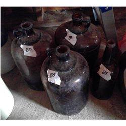 4 Brown glass Jugs