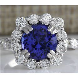 4.12 CTW Natural Blue Tanzanite And Diamond Ring In 18K White Gold