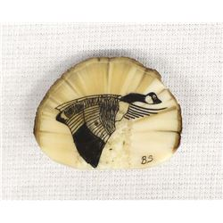 https://www.icollector.com/item.aspx?i=37221431Fossilized Walrus Ivory Scrimshaw Loon Brooch