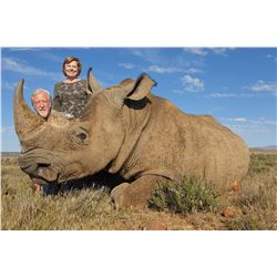 TAM SAFARIS: 7 Day Trip for 1 Hunter and 1 Non-Hunter for the Chance to Dart a White Rhino in South