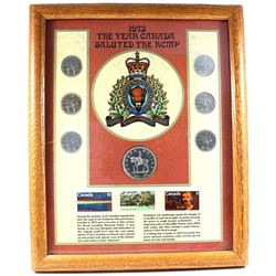 *1973 'The Year Canada Saluted the RCMP' 7-coin Set with 3x RCMP Stamps in Wooden Frame. The coins i