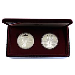 1984 & 1984 United States Olympic 2-coin Silver Proof Set (coins lightly toned & capsules lightly sc