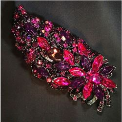 Contemporary violet rhinestone brooch with flower motif.