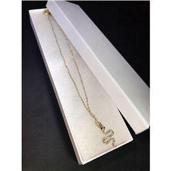 Golden designer necklace w/snake charm.