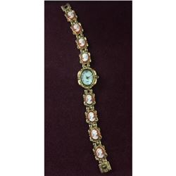 Elegant Ladies Gold Tone Quartz Watch with Unique Band