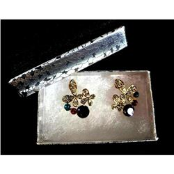 Designer cross earrings with colorful rhinestones.