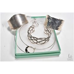 Selection of sterling silver jewellery including three cuff bracelets and two choker style necklaces