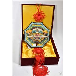 """Koji Pottery dragon's head motif wall hanging 9"""" in diameter, with red tassels in fitted presentatio"""