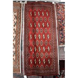 """100% handmade scatter rug with red background and highlights of brown, cream and blue, 23"""" x 53"""""""