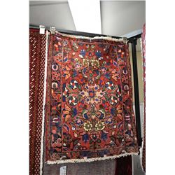 """100% handmade scatter rug with red background and highlights of blue, green, cream etc. 23"""" X 34"""""""