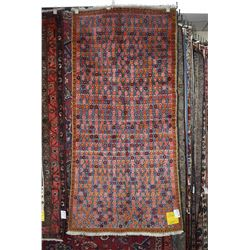 100% handmade Iranian carpet with overall multi coloured daisy pattern and fringed edge in shades of