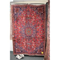 100% handmade Iranian Mashad carpet with center medallion, overall floral design, red background and