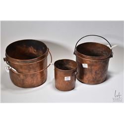 """Three graduated antique hand hammered copper pots ranging from 4 1/2""""-7"""""""