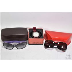 Two pairs of designer sunglasses including Coach and Miss Sixty plus a Fossil New York lady's wrist