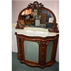 Victorian mahogany sideboard with three mirrored doors, marble top and backboard with oval mirror an