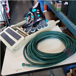 ROLLER BLADES GARDEN HOSE AND 2 STEP LADDER
