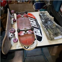 2 SKATEBOARDS, SKATEBOARD DECK, TIN SIGN, AND SNORKLE SET