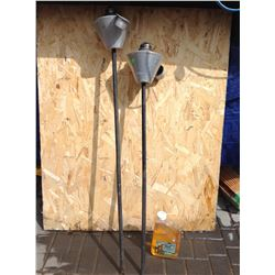 2 ALUMINUM OUTDOOR TIKI TORCHES, WITH BOTTLE OF OIL