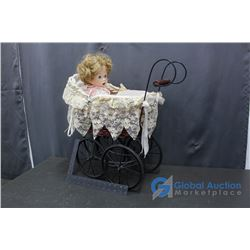 Doll in Large Buggy