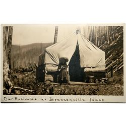 Bransonville, Idaho Real Photo Postcard, Women in front of homestead tent, cabin  (119938)