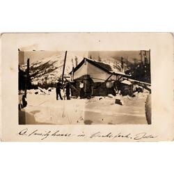 Clarks Fork, Idaho, Real Photo Postcard: Winter image of a homestead in Mountains  (119953)