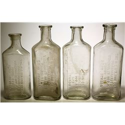 Four N. E . Wilson Co. Bottles  (57729)