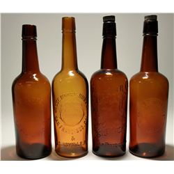 Four Embossed Tooled Top Whiskey Bottles (177940)