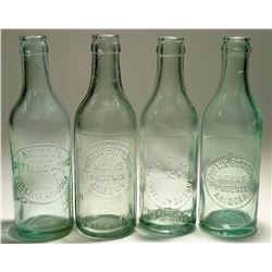 Four Phoenix Bottling Works bottles  (113089)