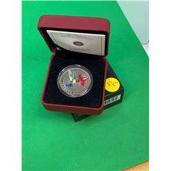 2007 CANADA COLOURED 25 CENT COIN.(RUBY THROATED HUMMINGBIRD)