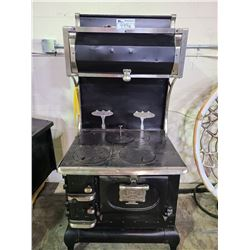 J. STEWART MFG CO LTD. WOODSTOCK ONTARIO VINTAGE STYLE CAST IRON WOOD BURNING STOVE NEVER USED