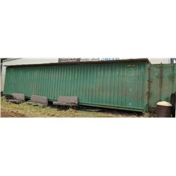 Green 40' Metal Shipping/Storage Container (buyer responsible for all costs of removable/transport).