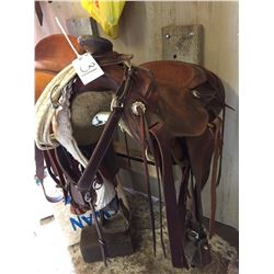 Western Rawhide Roper adult saddle comes with breast plate, and lariat,