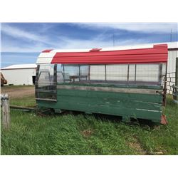 Covered sleigh green in color with tin and plexi  glass sides and roof, bench seats