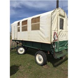 Tarp covered wagon, bench seats, zippered opening