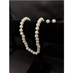 An Elegant Pearl Necklace And Earrings