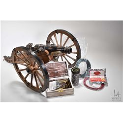"Miniature .69 caliber Spanish cannon. 26 1/2"" with wooden carriage. Includes selection of cannon bal"