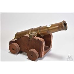 "Miniature brass 10 3/4"" cannon stamped Levesque on wooden cart"
