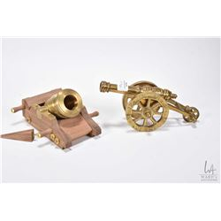 "Two miniature cannons including 6 1/4"" wooden cart with big bore cannon and a brass connon on a bras"