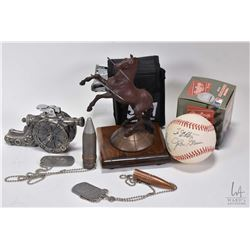 Selection of collectibles including Austronaut John Glenn autographed baseball, a set of Bushnell Jo