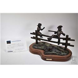 """G.C. Wentworth """"Pa's Buffalo Gun"""" cast bronze sculpture with cold painted ground cover on wooden bas"""
