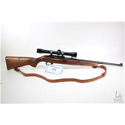 Non-Restricted rifle Ruger model 10/22 Carbine, 22LR ten shot semi automatic, w/ bbl length 18 1/2""