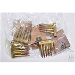 Selection of unidentified military ammunition on stripper clips, 59 rounds in total