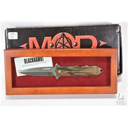 "Mod Tactical ""Blackhawk"" folding knife with Damascus blade, in wooden display"